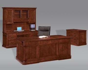 Executive suite consisting of executive desk, kneehole credenza, storage hutch and lateral file.