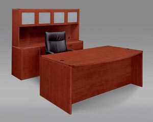 Executive desk, storage lateral file credenza, frosted panel door hutch shown in Cognac Cherry laminate finishe.