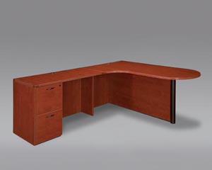 "Corner peninsula bullet ""L"" desk with full double file drawer pedestal."