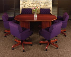 Large traditional octagon conference table with upholstered low back executive chairs
