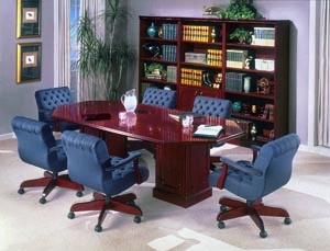 Traditional racetrack conference table with low back upholstered chairs