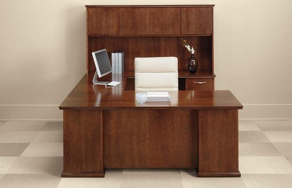 "Executive ""U"" desk consisting of a single pedestal desk, bridge, single pedestal credenza with overhead storage with doors"