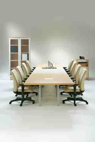 multiple rectangular tables with complementary furniture