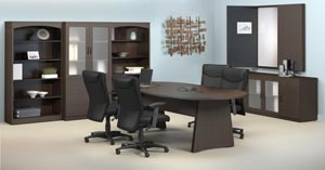 Conference room suite consisting of race track conference table, buffet, conference cabinet with white erase board, two bookcases and a storage bookcase cabinet with frosted panel doors shown in the Mocha laminate finishes.