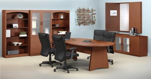 Conference room suite consisting of race track conference table, buffet, conference cabinet with white erase board, two bookcases and a storage bookcase cabinet with frosted panel doors shown in Cherry laminate finishes.