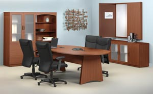 Conference room suite consisting of race track conference table, buffet, conference cabinet with white erase board, a bookcase and a storage bookcase cabinet with frosted panel doors shown in both the Mocha and Cherry laminate finishes.