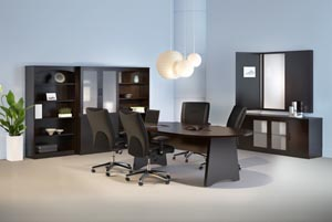 Conference room suite consisting of race track conference table, buffet, conference cabinet with white erase board, two bookcases and a storage bookcase cabinet with frosted panel doors shown in Mocha laminate finish.