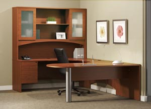 "Peninsula ""U"" shaped desk with single pedestal credenza, bridge and hutch with frosted panel doors."
