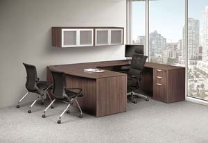 "Bow front ""U"" desk with hanging storage units."