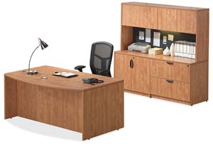 Bow front executive desk, storage lateral file credenza with storage hutch and tack board.