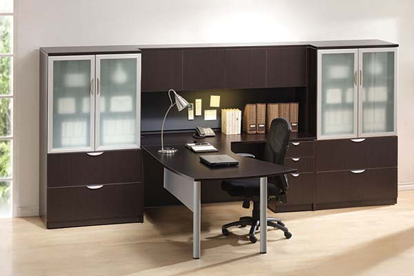 """Arc table """"L"""" desk with wall unit consisting of storage hutch with doors and two lateral file storage cabinets with silver trimmed doors and frosted glass."""