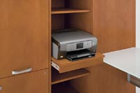The Technology Cabinet's pull-out shelf is for laser printers or multifunction devices, with adjustable open shelving above and below