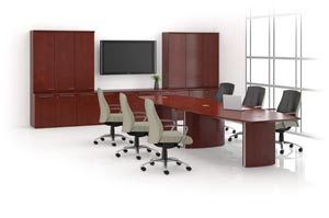 Boat shaped conference table with wall unit consisting of a buffet and wall cabinets.