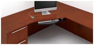 The effect of the Technology Top's sweeping geometry recognizes user preferences for corner placement of computers.