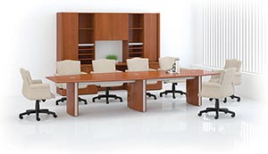 Boat shaped conference table with wall unit.
