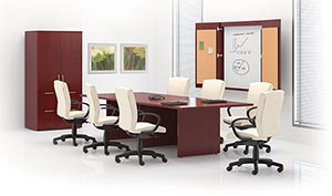 Rectangular conference table, lateral file storage cabinet and presentation cabinet.