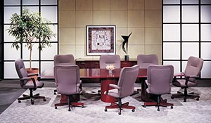 Rectangular conference table with round bases and buffet cabinet.