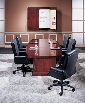 Traditional boat shaped conference table with presentation cabinet.