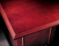 Hardwood edges with mitered corners distinguish