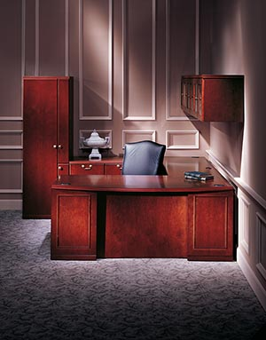 Single Pedestal Desk - Right with Bow Top, Executive Bridge Top and Modesty Panel, Rectangular Worksurface and Modesty Panel, and Modular Multi-File Pedestal. 108-inch Hanging Cabinet with Glass Doors and Organizer Wardrobe shown in Cordovan Cherry