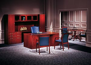 "Partner's Office: Bow Top Executive Desk, Kneespace Credenza, and 48"" diameter Executive Round Table, Upper Bookcases, with Personal Cabinet and Single Wardrobe shown in Light Cherry."