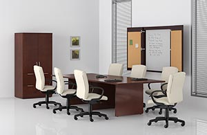 Rectangular conference table with two drawer lateral file with audio/visual cabinet on top and presentation board.