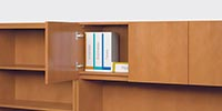Overhead storage units accommodate standard-height binders.