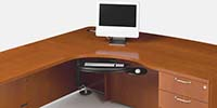 The CRT desk demonstrates Revolve's wire management features.