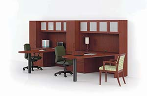Revolve D-Top Conference Extensions with Credenzas, Personal Cabinets and Upper Bookcases. Shown in Light Cherry laminate with Crescent edge and Bead pulls in Matte Black