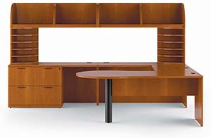 Revolve Key Hole Top, Optional P-Top Modesty Panel, Executive Bridge Top, Lateral File Pedestal, Wing End Panel, Rectangular Worksurfaces, Upper Shelves and Upper Bookcase Letter Trays. Shown in Golden Cherry with Cove edge and Cable pulls in Matte Black