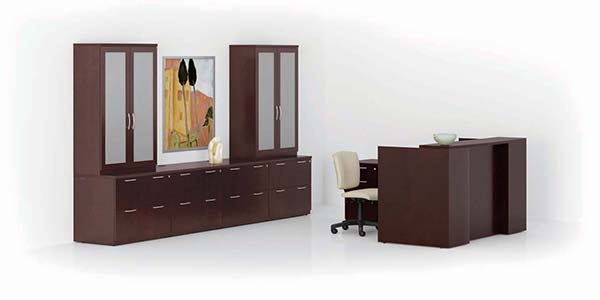 """Revolve Reception/Workstation, Lateral Files, 84"""" High Bookcases with doors and Modular Cabinet Tops. Shown in Espresso on Cherry with Reeded edge and Bead pulls in Matte Chrome"""