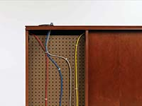 Removable panels on the desk's approach side conceal wire management capabilities built inside the furniture. Wires route through end panel, top and interior grommets.